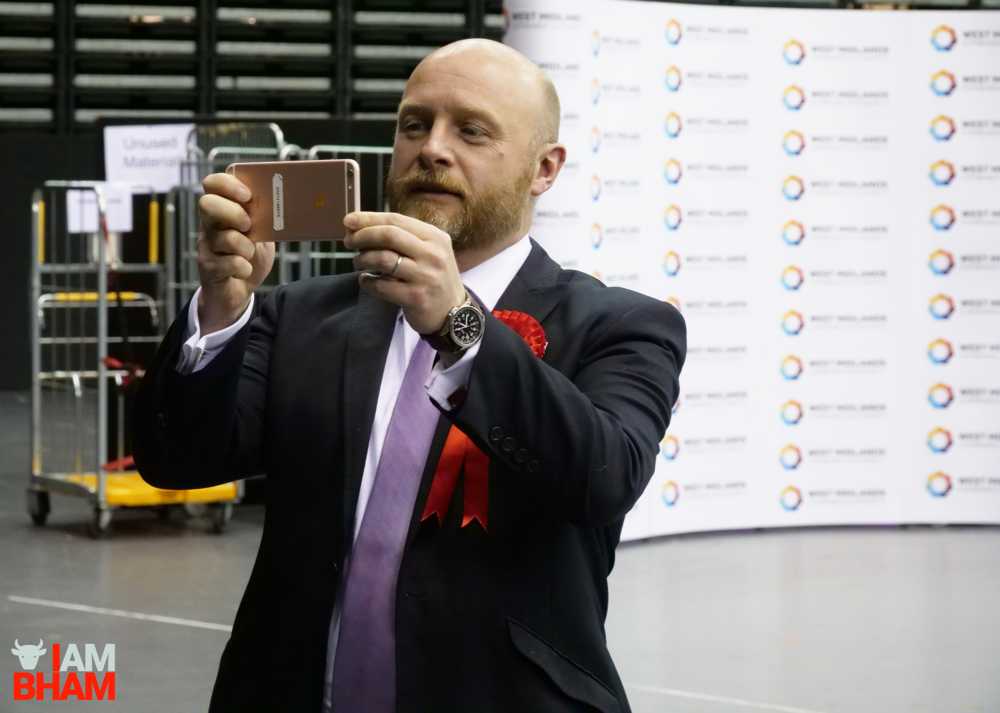 Birmingham Hodge Hill MP Liam Byrne takes a photo during the West Midlands Mayoral Election vote count