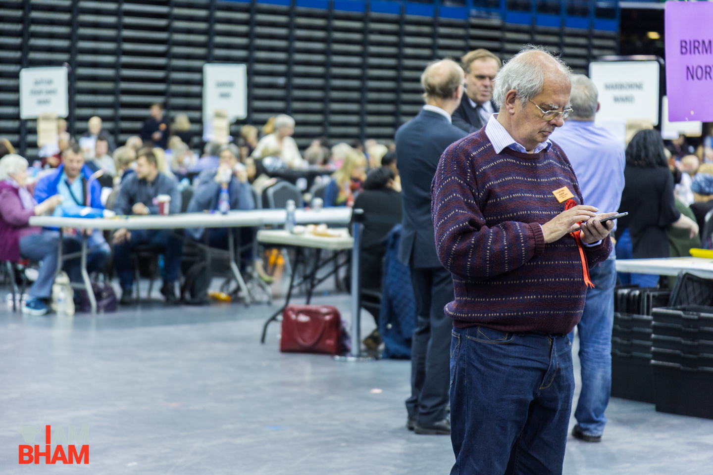 A Labour supporter checks his phone at the West Midlands Mayoral Election vote count in Birmingham