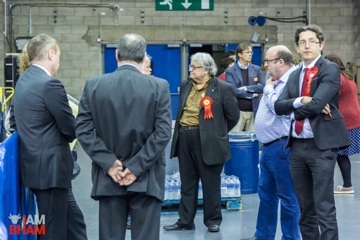 Communist candidate Graham Stevenson chats to supporters at the West Midlands Mayoral Election count in Birmingham