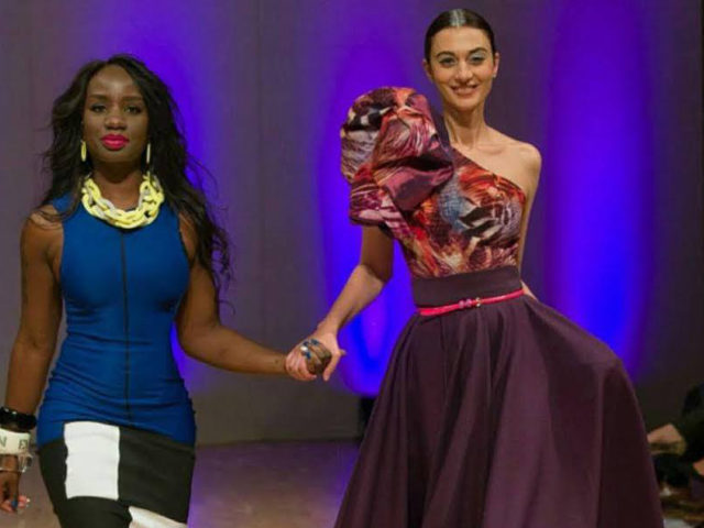 Paulinah Eboh-Sampson, co-founder of the Donation UK Project, joined by a model showcasing womenswear label Dolls of Decadence