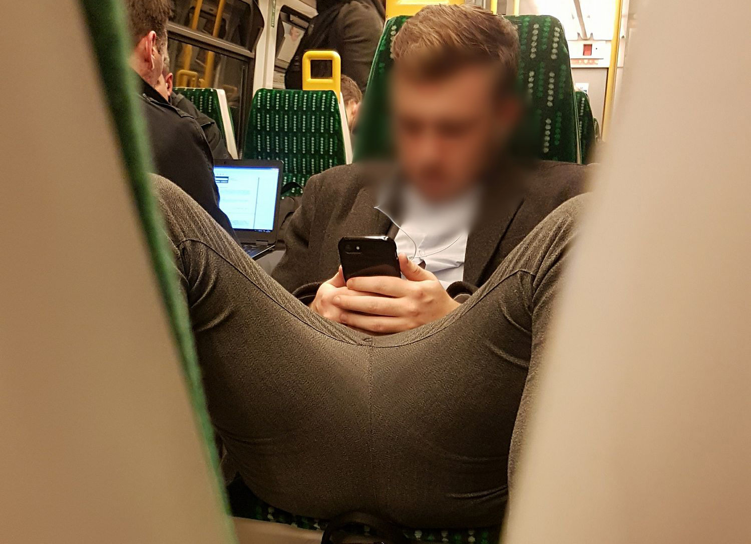 "Passenger on Birmingham train displays some extreme ""manspreading"" skills"