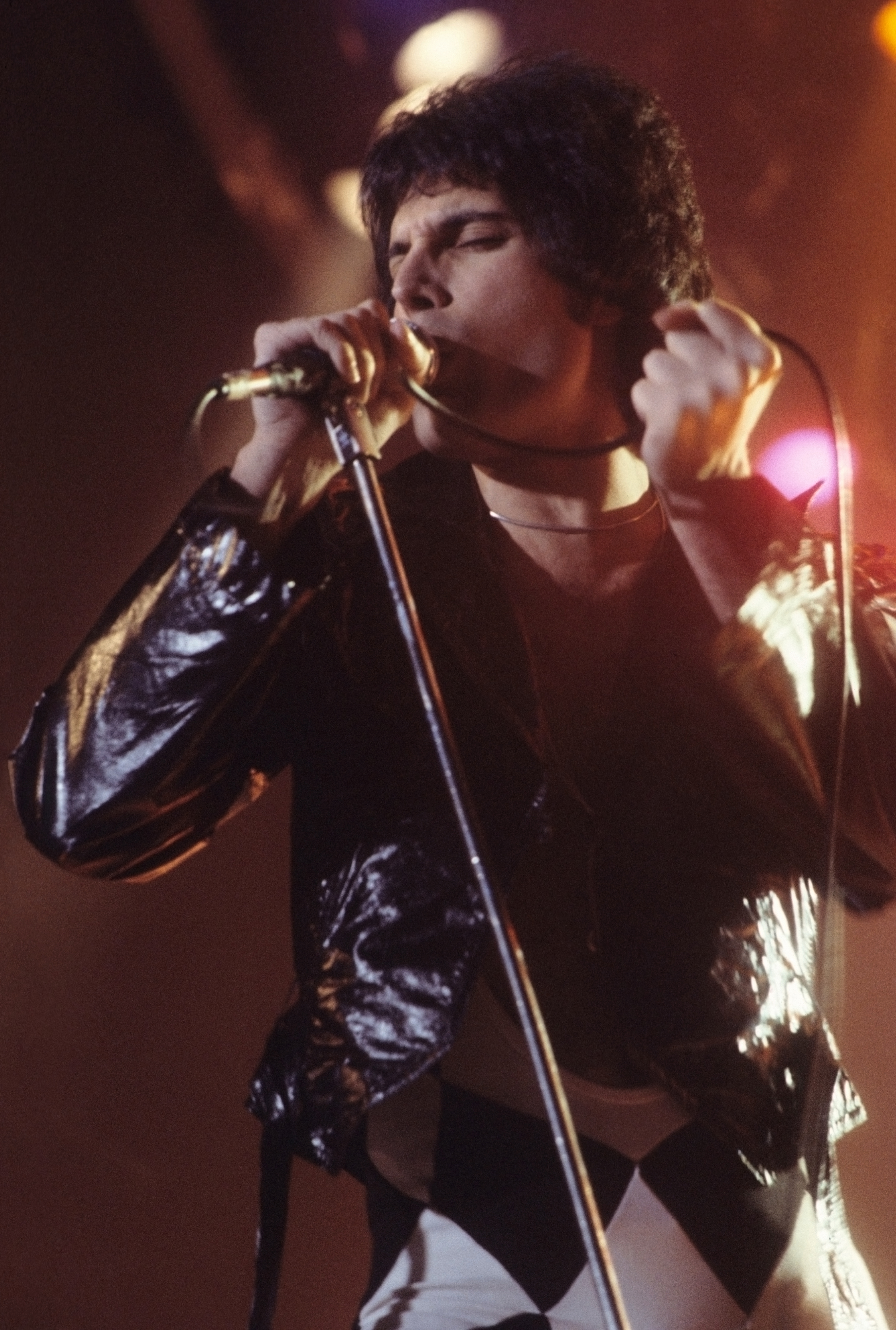 """Queen lead singer Farrokh """"Freddie"""" Mercury, photographed here performing in New Haven in November 1977, died from bronchial pneumonia resulting from AIDS in 1991."""