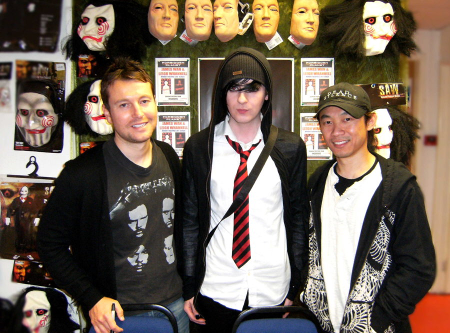 Leigh Whannell (left) and James Wan (right) with horror fan and artist Discord C. Bam Bam