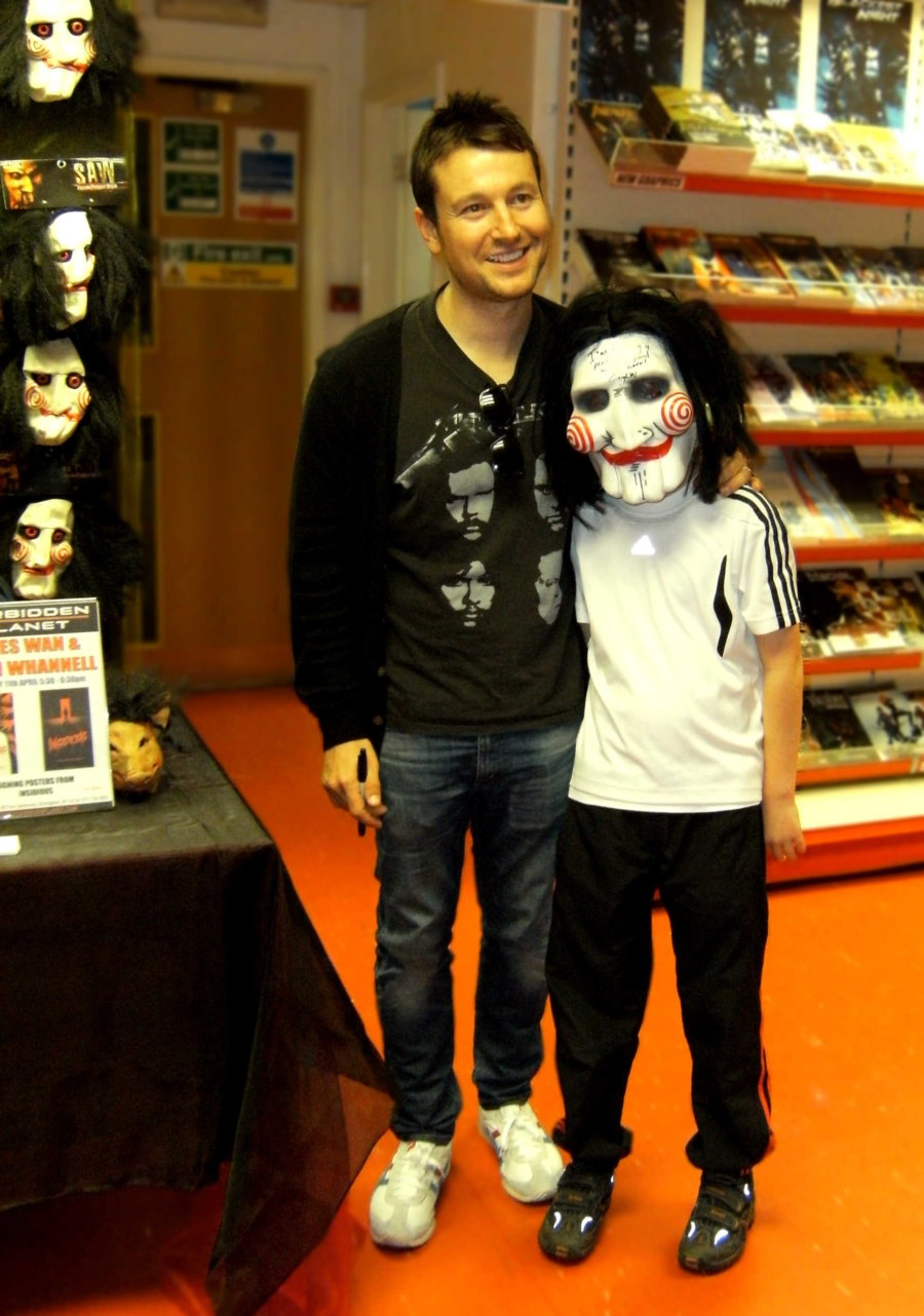 Leigh Whannell with a young fan dressed up as Billy the Puppet from the SAW film franchise