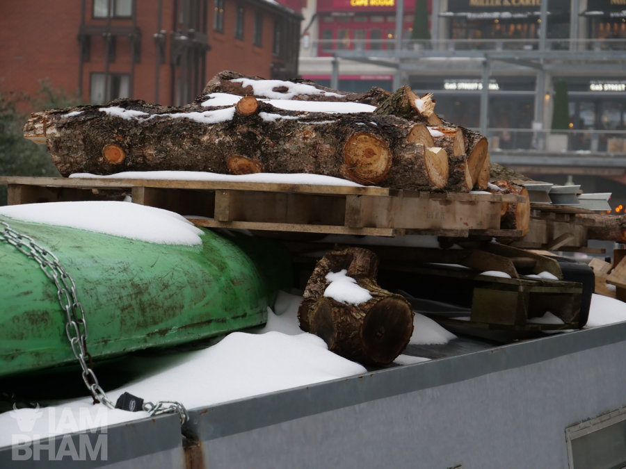Fire wood rests on top of a canal boat as cold temperatures cause the canals to freeze