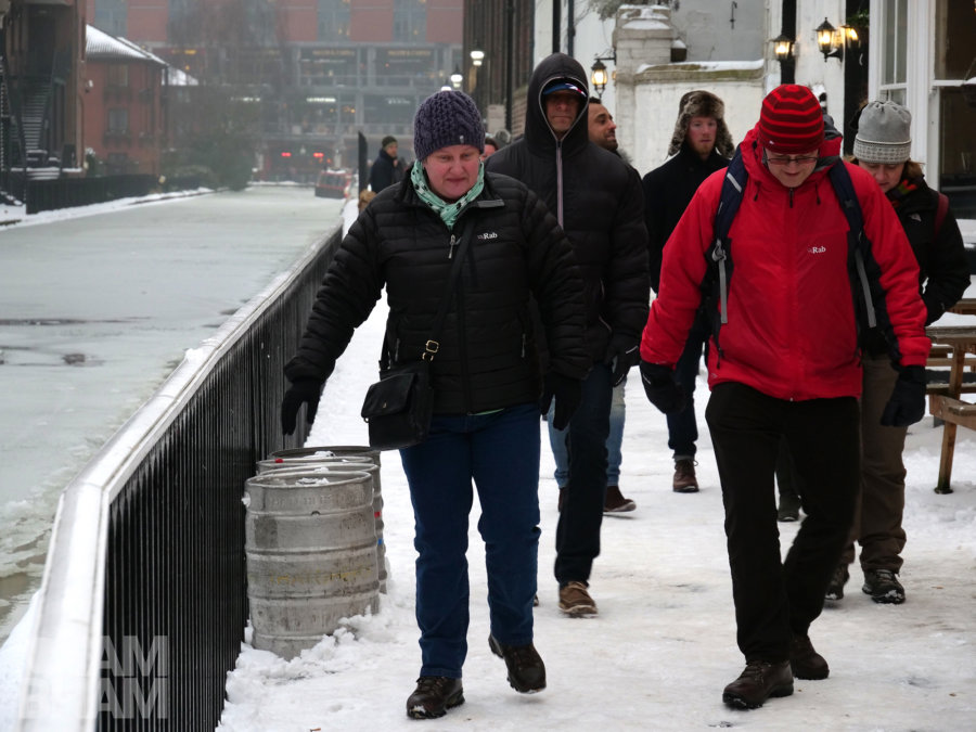 Passers-by trying not to slip as they walk alongside frozen canals in Birmingham