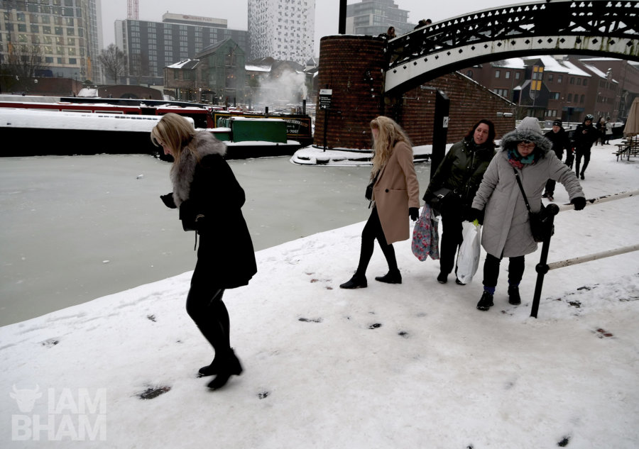 Friends walking beside a frozen canal in Birmingham, trying not to fall onto the ice