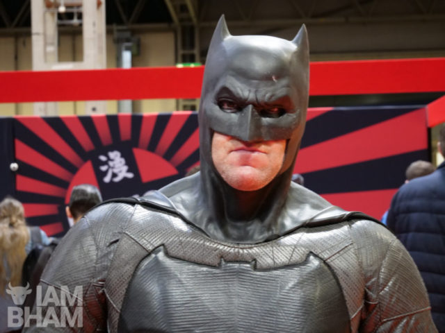 A comic fan dressed up in Batman cosplay at the MCM Comic Con in Birmingham