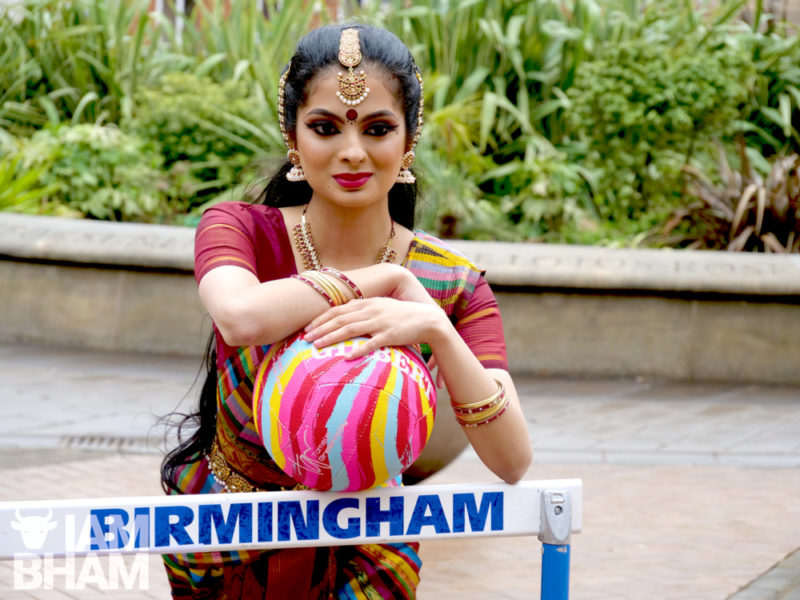 Anaya Bolar, from South-Asian arts group Sampad, demonstrating the entertainment Birmingham will be staging in Victoria Square on Saturday to welcome home Team England
