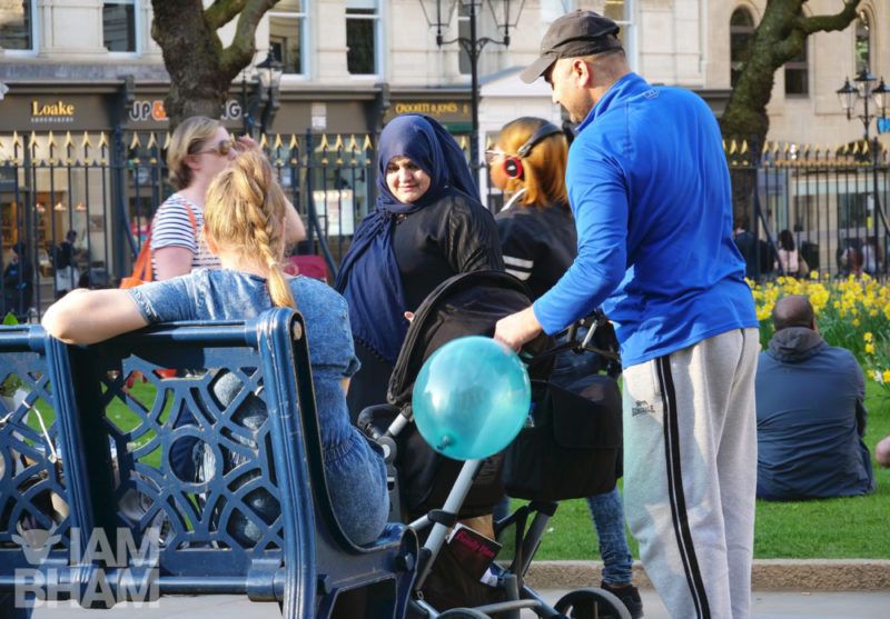 A family with their child chat with new friends in Colmore Row in Birmingham