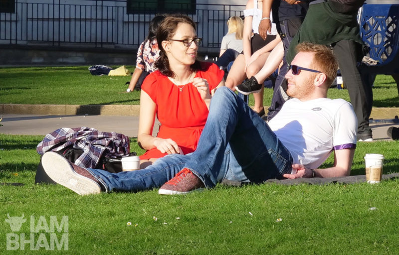 A couple are all smiles in Cathedral Square in Birmingham city centre