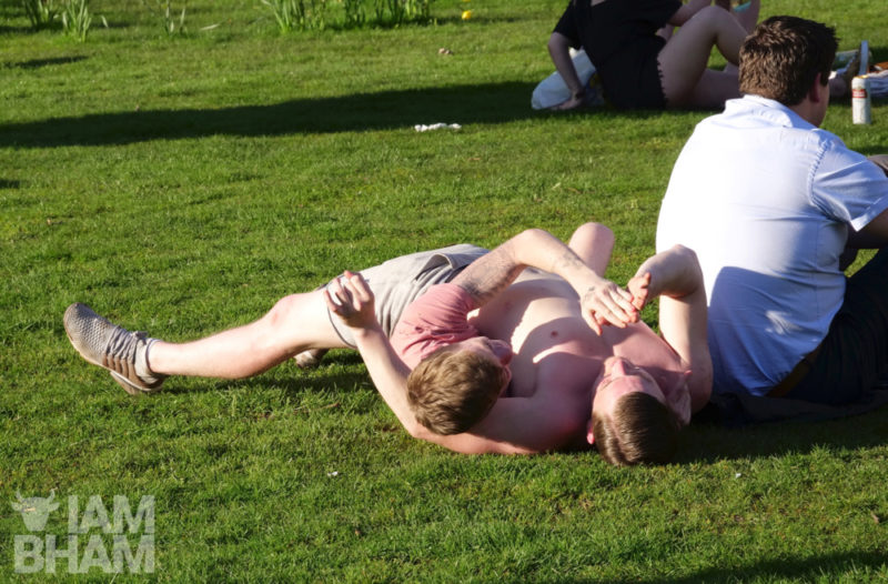 Two lads having a playful tussle in Pigeon Park (Cathedral Square) in Birmingham