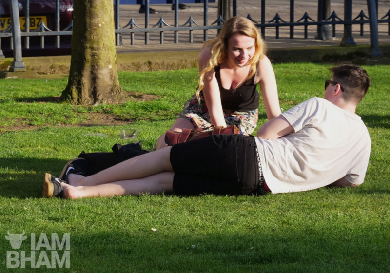 A woman relaxes with a friend in Birmingham's Cathedral Square