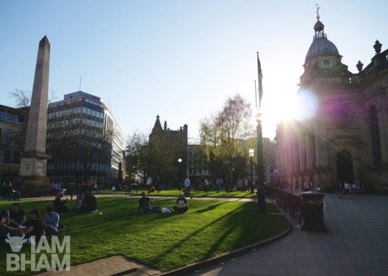 Brummies relax in the green around St. Phillip's Cathedral in Birmingham city centre
