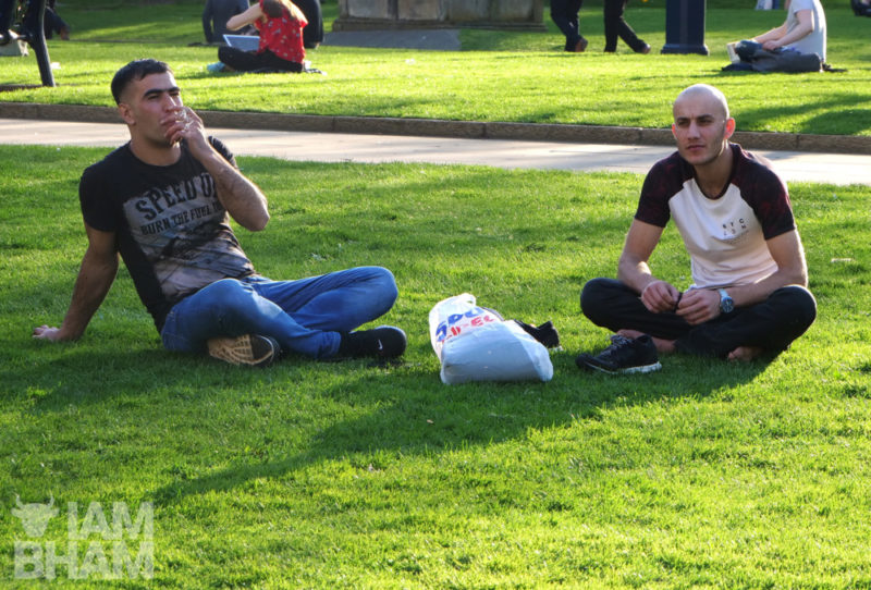 Two young men relaxing in Cathedral Square in Birmingham