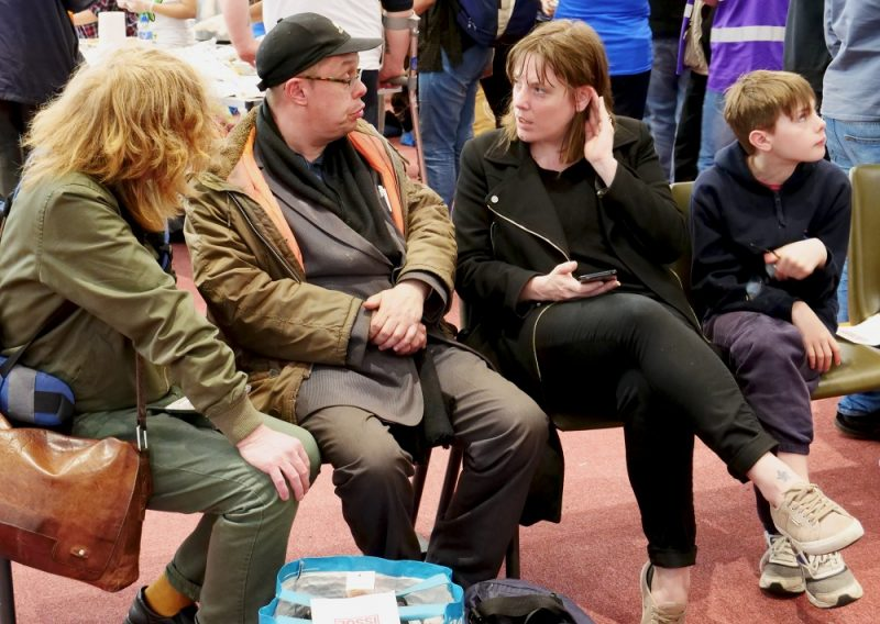 Jess Phillips MP chats to homeless individuals at a Birmingham Food Drive event