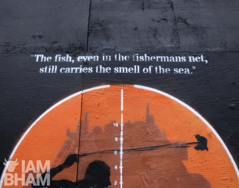 "The stencil art of Fadi Abu Salah features a quote by Palestinian writer and poet Mourid Barghouti, which reads, ""The fish, even in the fisherman's net, still carries the smell of the ocean."""
