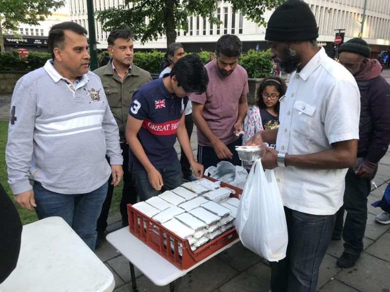 Birmingham Outreach Foundation founder Shahed Syed (left) and volunteers distributing food to the homeless during Ramadan