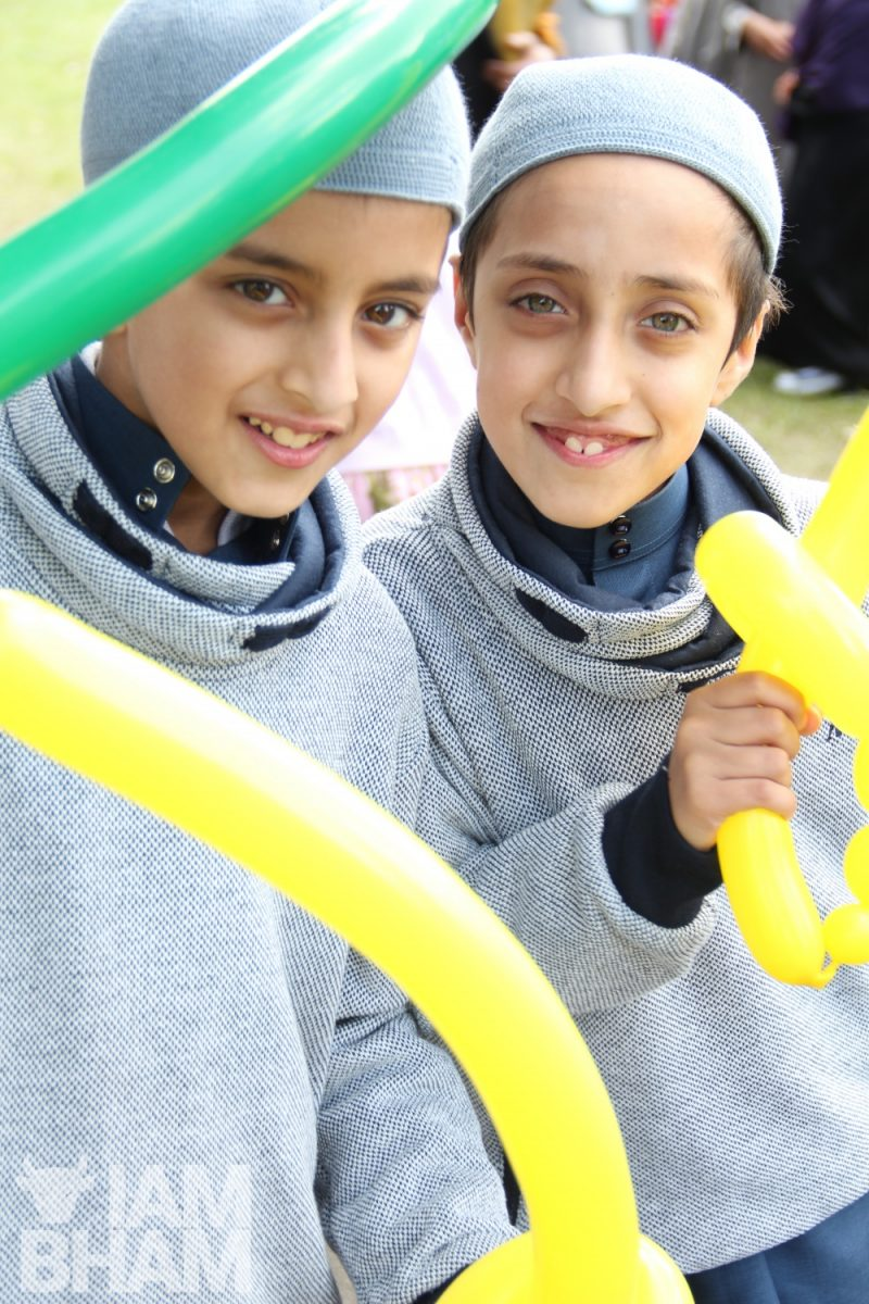 Eesa and Musa with modelling balloons at the Eid festival in Small Heath Park