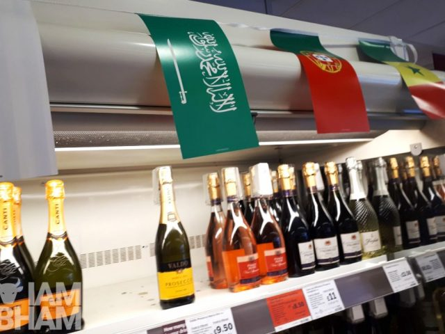 A flag bearing the Islamic declaration of faith being used to promote alcohol sales at Sainsbury