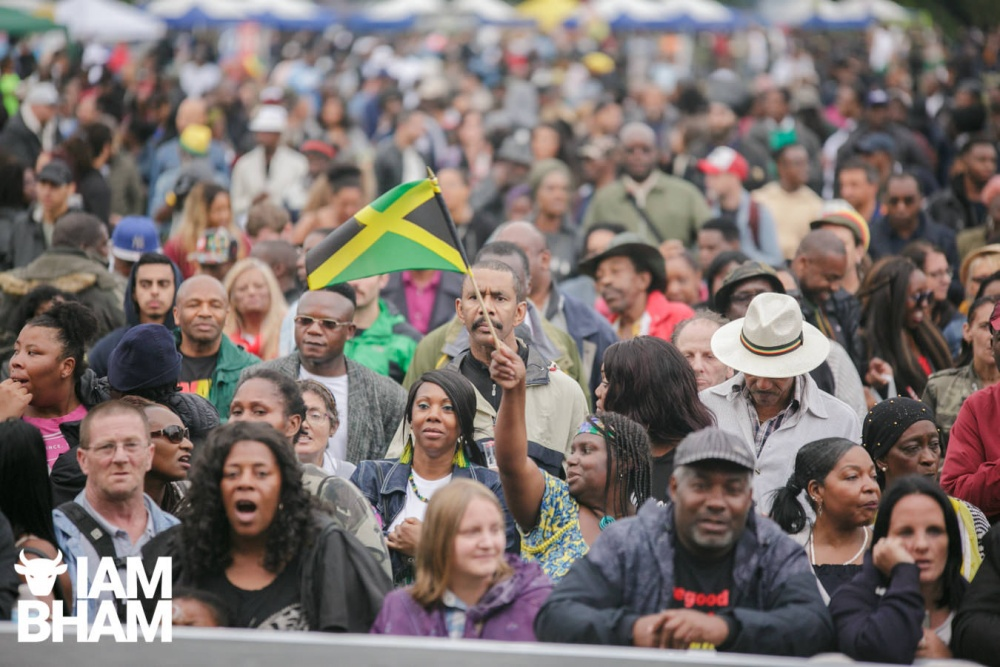 Jamaican flag and crowds at Simmer Down Festival 2018