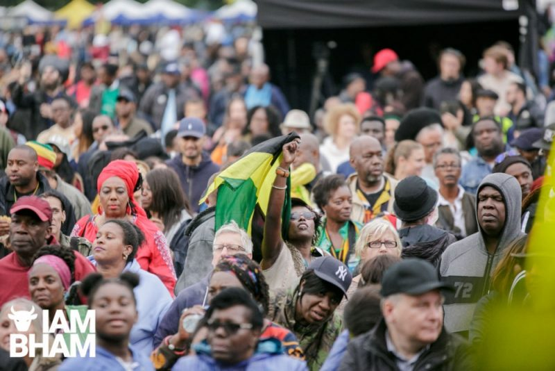 The Jamaican flag flies in the crowd at Simmer Down Festival 2018 in Birmingham UK