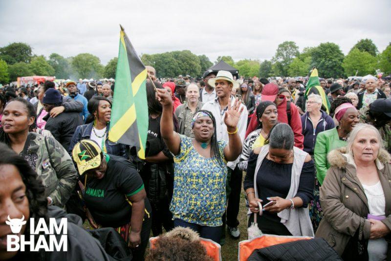 Jamaican flag held high at Simmer Down Festival 2018 in Handsworth Park in Birmingham UK