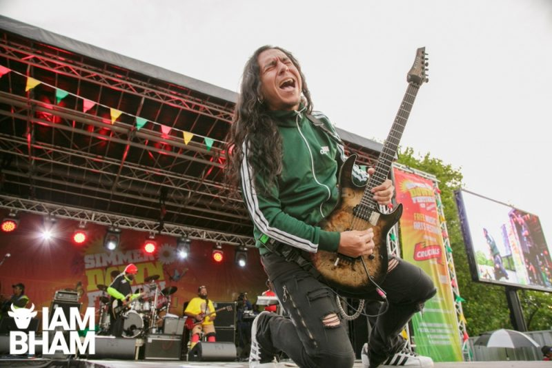 Inner Circle guitarist performs on the main stage at Simmer Down Festival