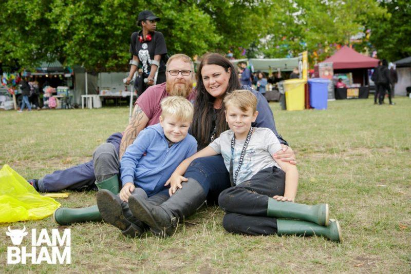 A family enjoying the Simmer Down Festival 2018 in Handsworth Park in Birmingham