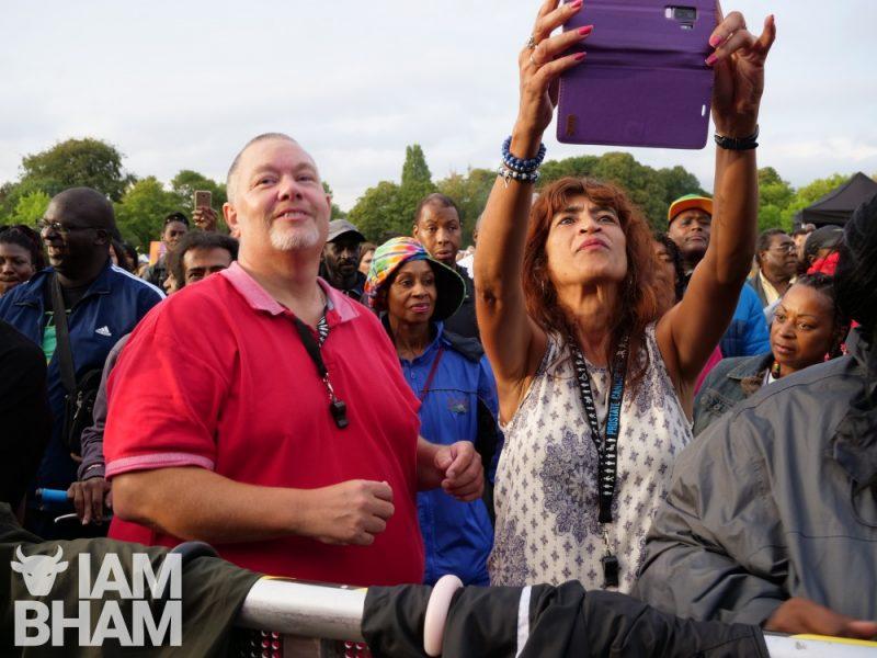 Revellers filming on smart phones at Simmer Down Festival 2018 in Birmingham