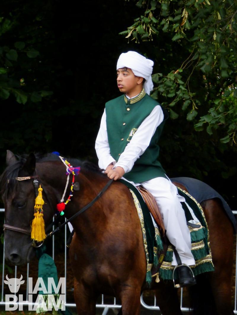 Horse rider tent pegging
