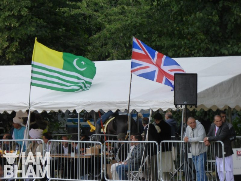 Union Jack flag and Pakistani Azad Kashmir flag side by side
