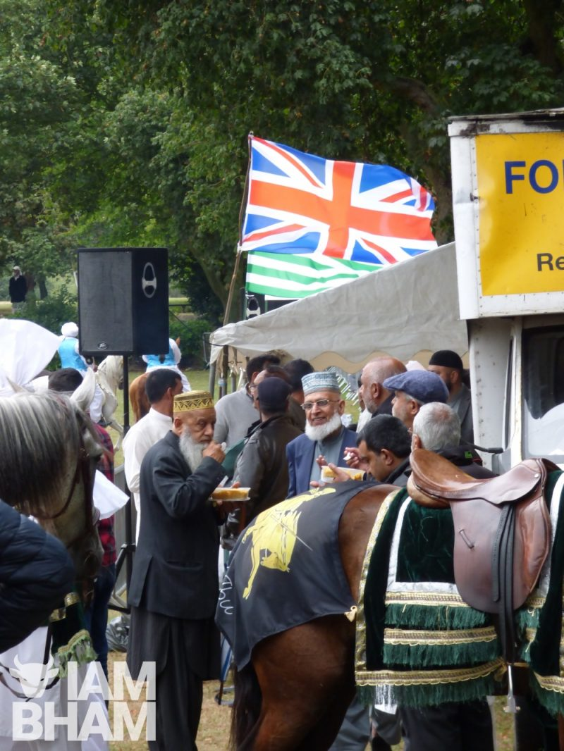 South Asian Muslim men under the Union Jack flag