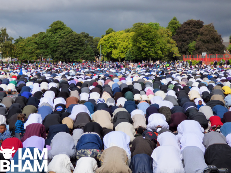 Worshippers in prostration during Eid al-Adha services in Small Heath Park in Birmingham