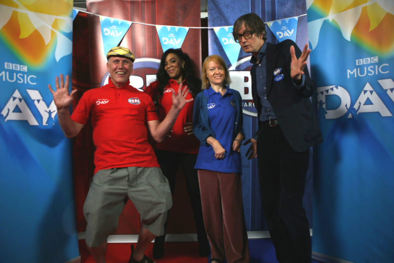 Jarvis Cocker with Candida Doyle take on Bez and Rowetta Idah in a Pulp versus Happy Mondays Bargain Hunt special for BBC Music Day.