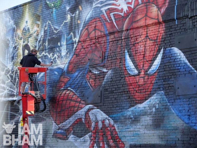 Artist Jim Vision working on the large-scale PS4 Spider-Man mural in Digbeth in Birmingham