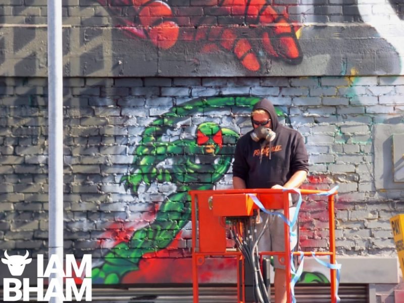 Artist Jim Vision making final touches to his PS4 Spider-Man mural in Digbeth, Birmingham