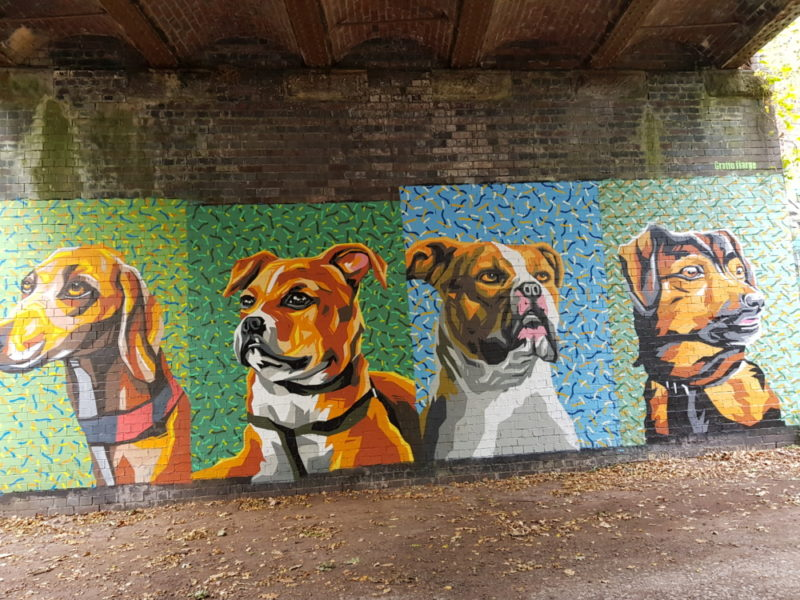 Street art of dogs along Market Lane bridge