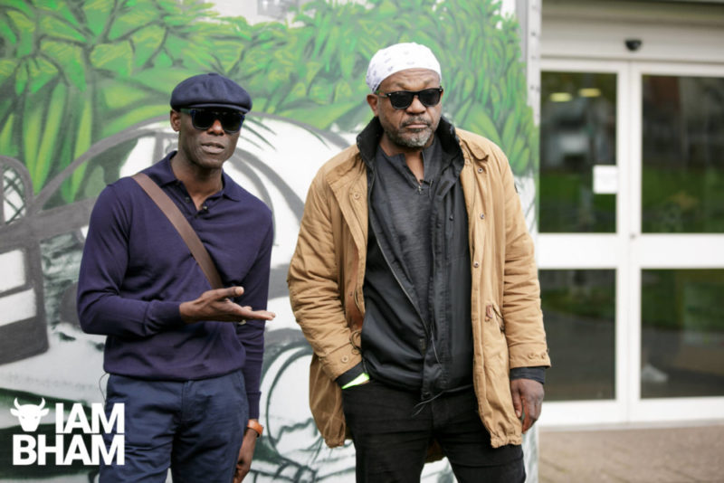 Steel Pulse founding members Mykaell Riley and Basil Gabbidon in front of a special mural tribute to the band