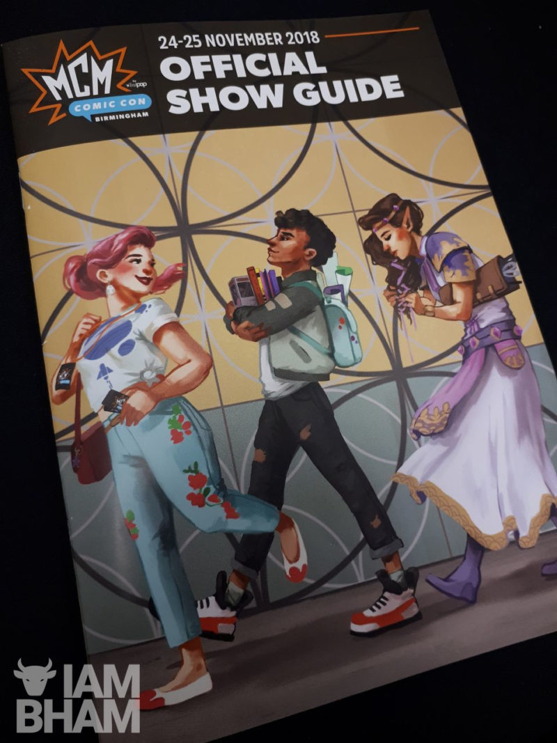 The official MCM Comic Con Show Guide featuring a special cover by illustrator Anna Hollinrake, depicting the Library of Birmingham