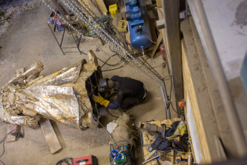 Luke Perry putting the finishing touches to the Lions of the Great War statue at the studio in rural Shropshire