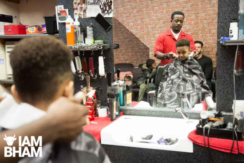 Josiah Sharpe getting his hair cut at a local barbers in the West Midlands