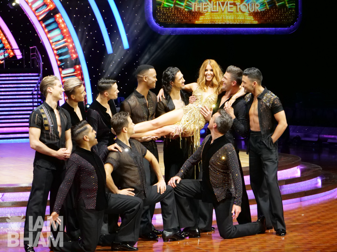 Strictly Come Dancing winner Stacey Dooley is held aloft by the male celebrities and dancers taking part in the live show