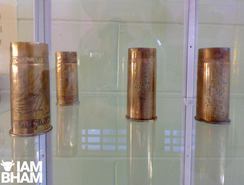 Empty ammunition shells from the trenches become works of art after soldiers decorate them