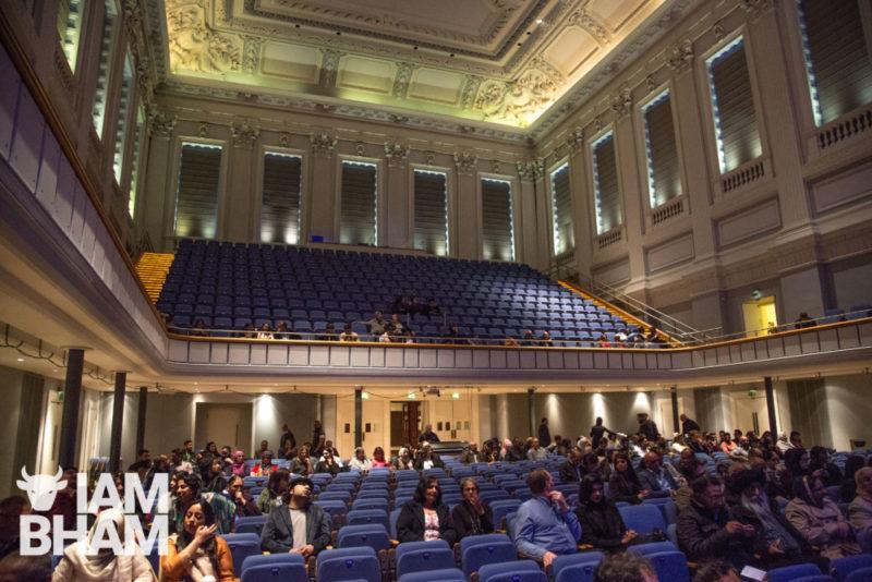 Fans of qawalli music begin to fill Birmingham's Town Hall.