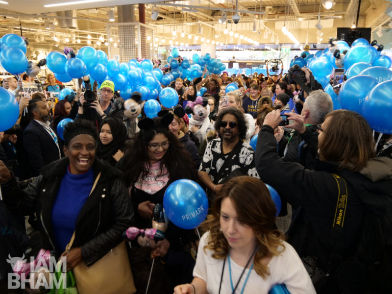 Customers rush into the new Primark store following its grand opening