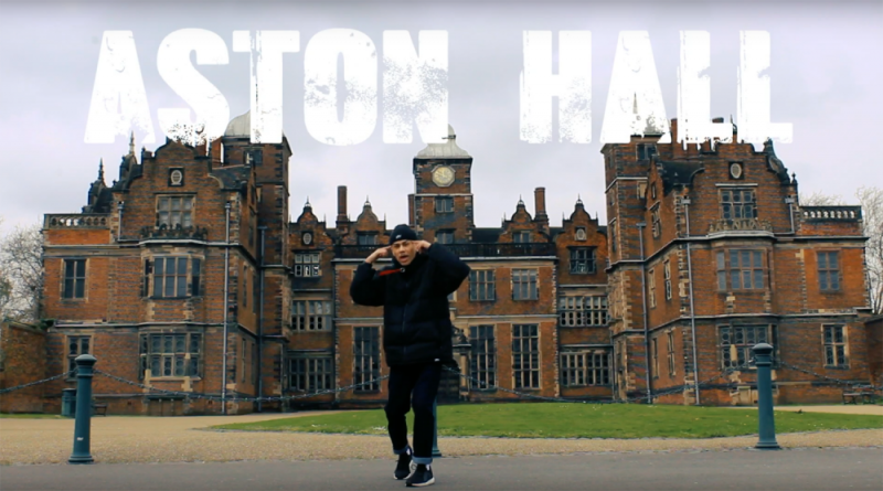 Tarju Le'Sano in front of Aston Hall for his 'Communities Breathe' collaboration with Punch Records