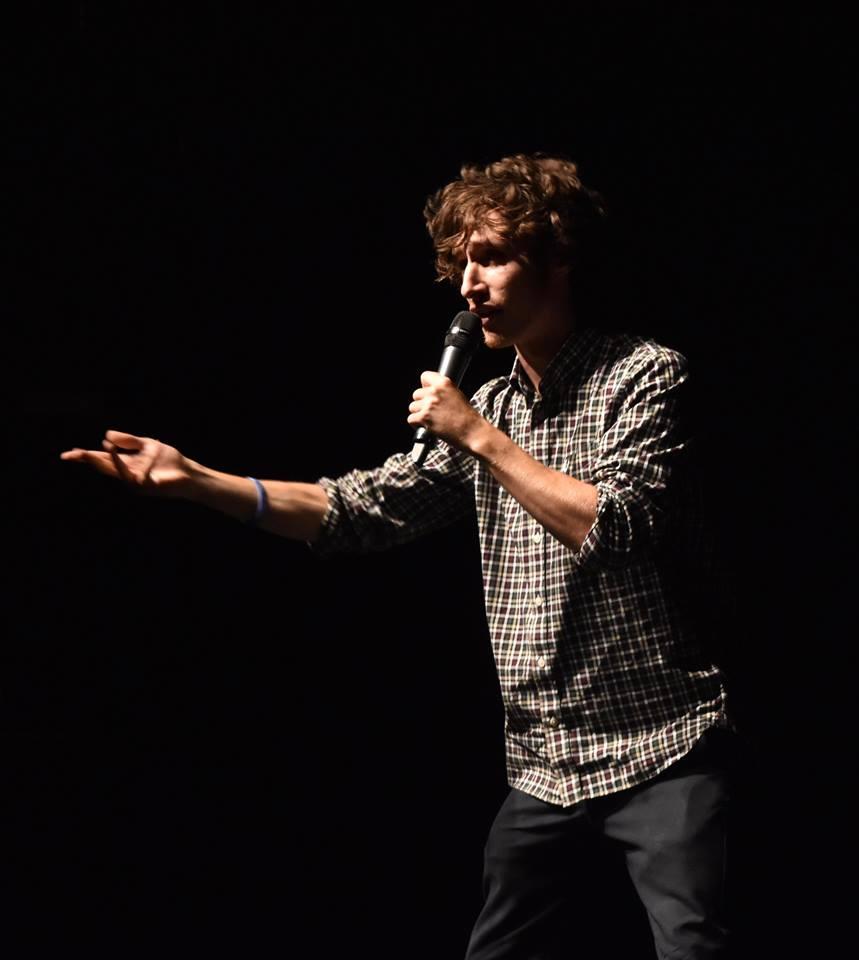 Dyslexic Birmingham artist Joe Cook performing poetry