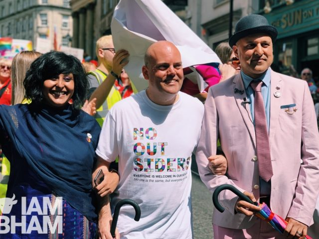 Andrew Moffat, alongside Saima Razzaq and Khakan Qureshi, at the front of this years Pride parade