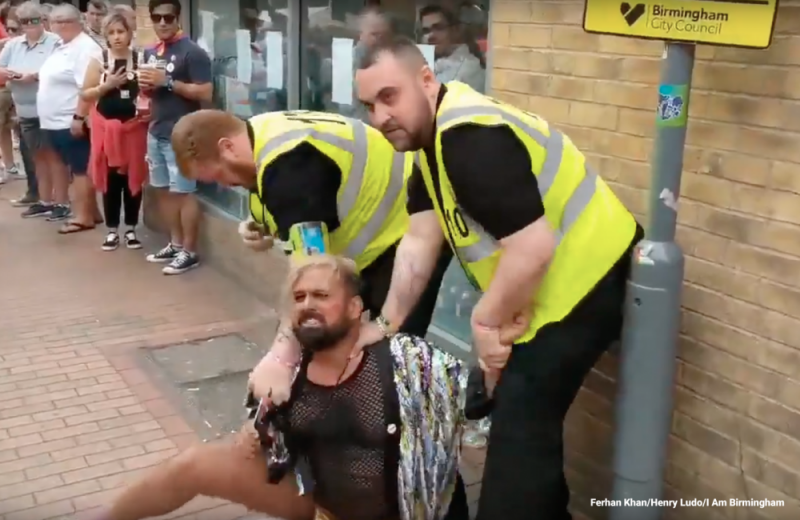 Ferhan Khan being restrained by security staff in Hurst Street during Birmingham Pride